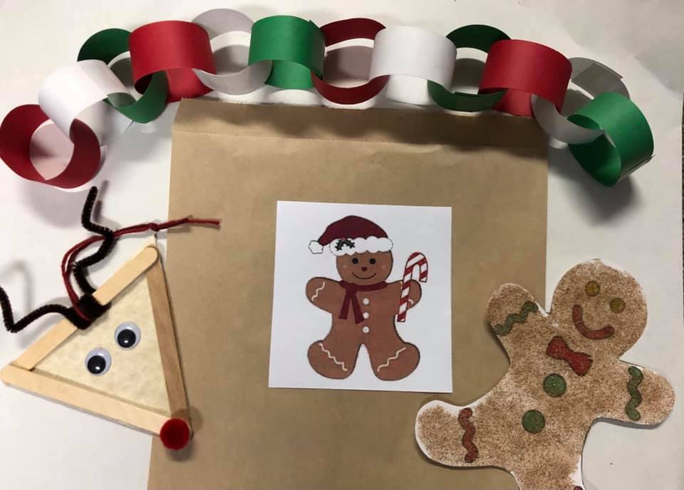 Image of craft bag with gingerbread person on front of bag and crafts for preschoolers beside of the bag